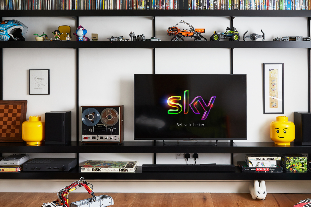 Black shelving system designed as a TV and media unit