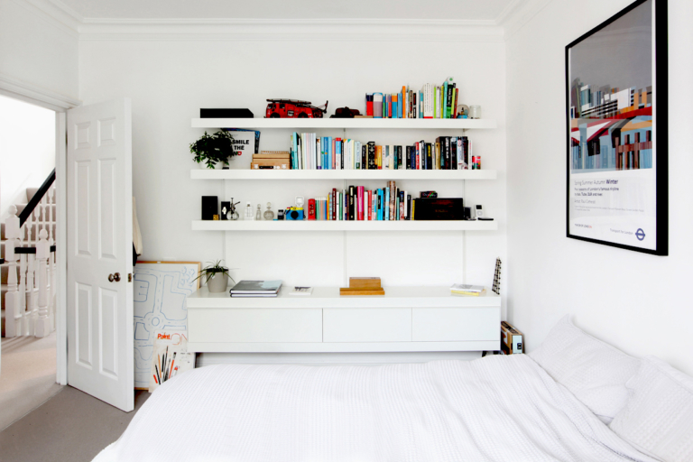 White shelving system with cabinets and shelves
