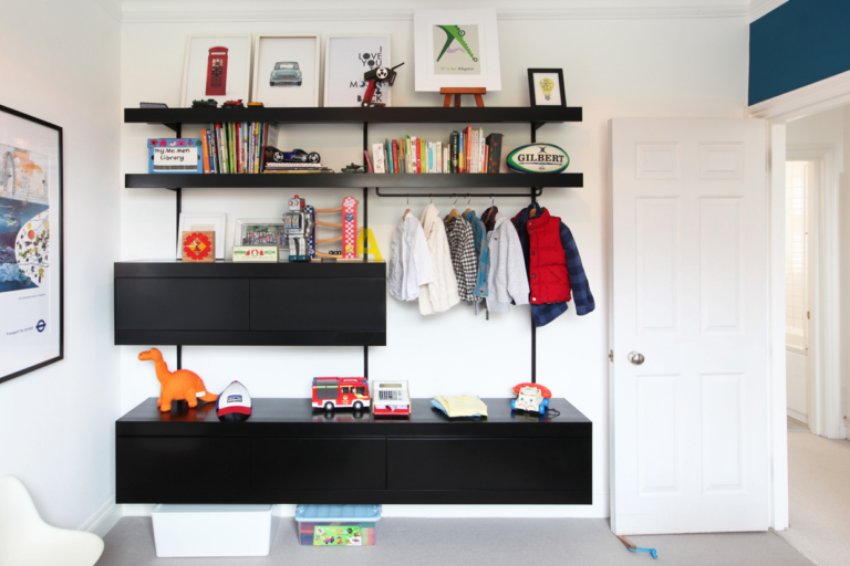 Black wardrobe shelving system with cabinets